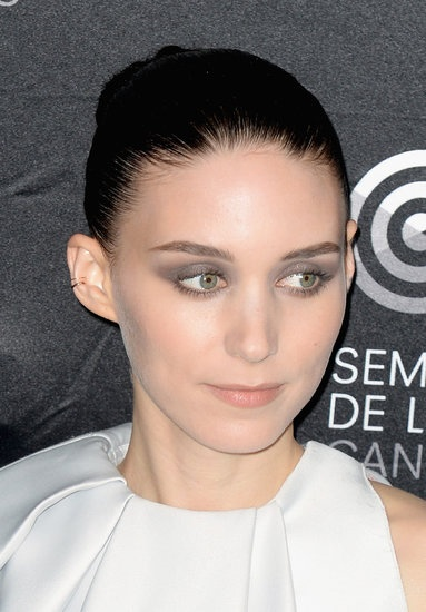 Rooney Mara wore an array of gray eye shadows and her hair slicked back into a tight bun at the Ain't Them Bodies Saints photocall. #Cannes