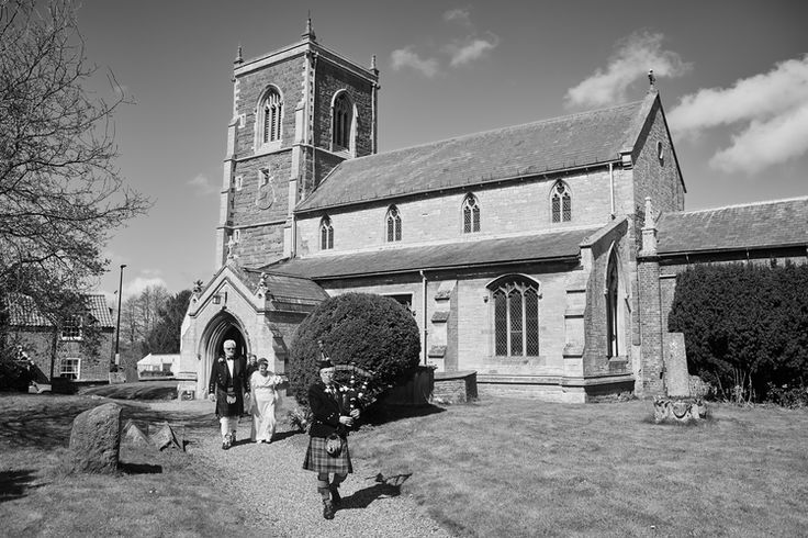 The newly married couple leave church on theirbeautiful wedding day in Partney, Lincolnshire.