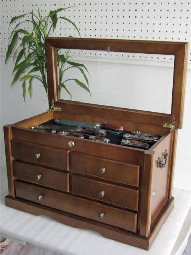 Collector's Choice Knife Display Case Cabinet, storage cabinet, Solid Wood, Gallery Quality by Displaygifts.com Display Cases at Factory Direct. $239.95. Crafted from solid wood. Shadow Box top, with see glass cover. Awsome item for knife storage. Drawers are lockable. This piece is the best you can get for a serious knife collector. A great way to display your collectible knives with the see thru glass top. 5 drawers providing much extra room storage. The dra...