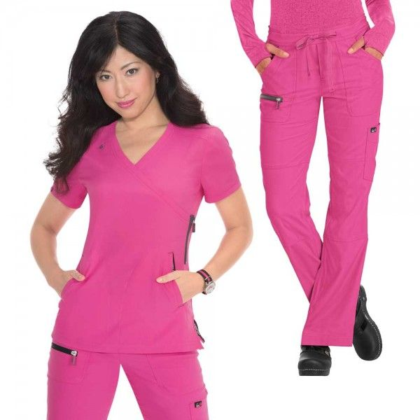 Koi Lite Philosophy Set in Flamingo consists of the Philosophy Top paired with the Peace Trousers. This set is lightweight, moisture wicking, wrinkle free and stretchy. The top features two side pockets and side slits for a comfortable fit. The trousers have a drawstring waist and multiple pockets. At only £59.99 #nursescrubs #dentistscrubs #nurses #dentists #pinkscrubs