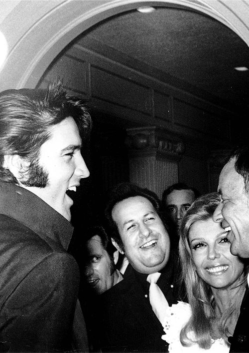 Elvis Presley at Nancy Sinatra's opening night in Las Vegas, NV, August 29, 1969. Elvis, Charlie Hodge, Joe Esposito, Nancy Sinatra, Frank Sinatra (and Fred Astaire, not shown in the picture) during the post show party.