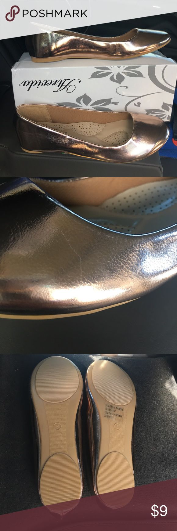 Rose gold champagne colored flats size 6 Brand new Brand new still in box size 6 metallic flats. I would call them rose gold or champagne color. I bought them for my daughter without having her try them on first and they didn't fit but I waited too late to return them. They have never been worn. There is one teeny tiny scratch that you can barely see on one of the shoes. Atrevida Shoes Flats & Loafers