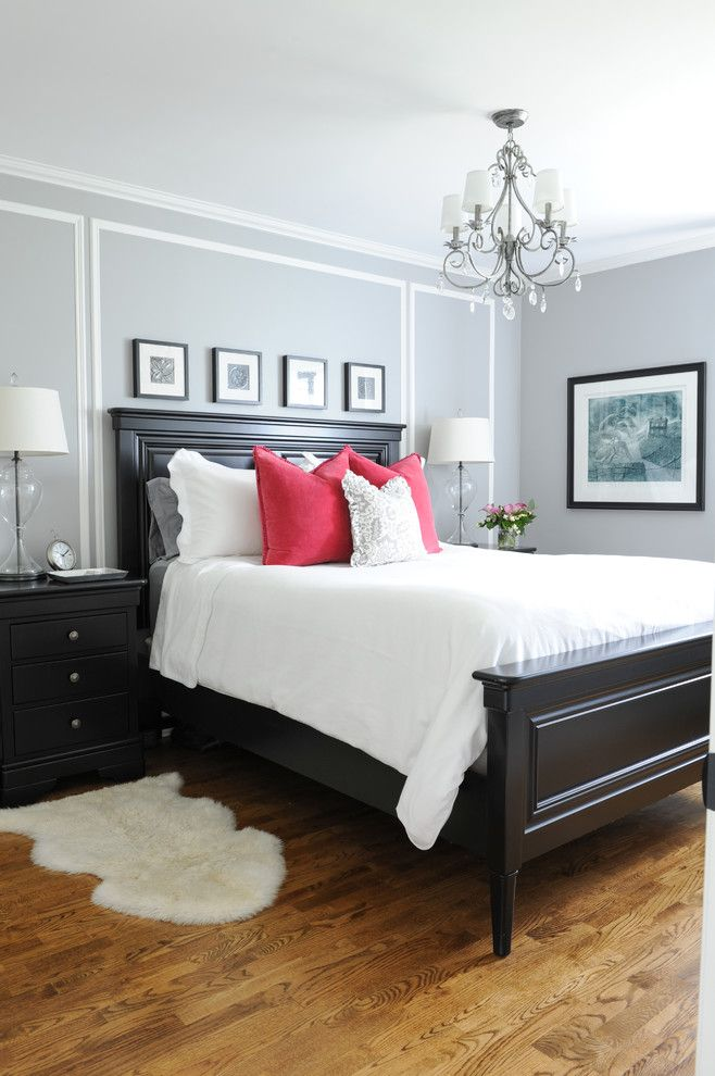 Master bedroom with his and hers nightstands, gray walls, white bedding with red accent pillows | Simply Home Decorating