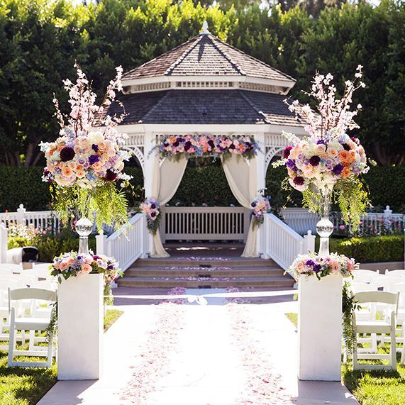 Whimsical blooms at a wedding ceremony in Disneyland's Rose Court Garden