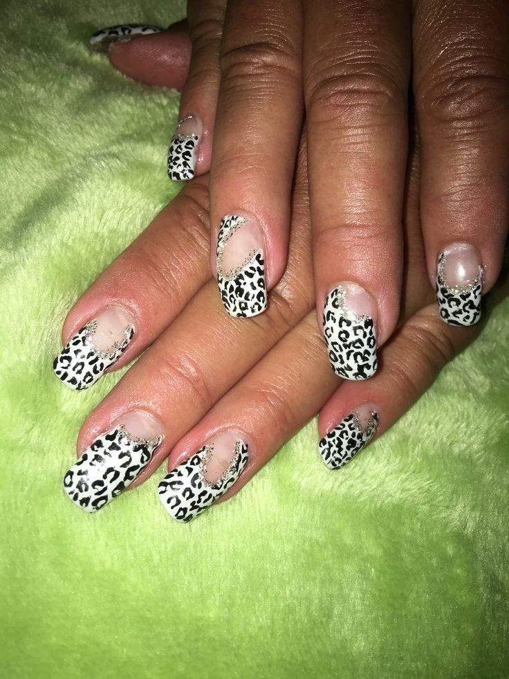 Black amd elite with negative space cheetah print nails. With silver sparkle lines.