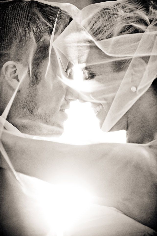 LOVE this shot through the #weddingveil. Must have photo, and so beautiful in black and white! Image by True Photography