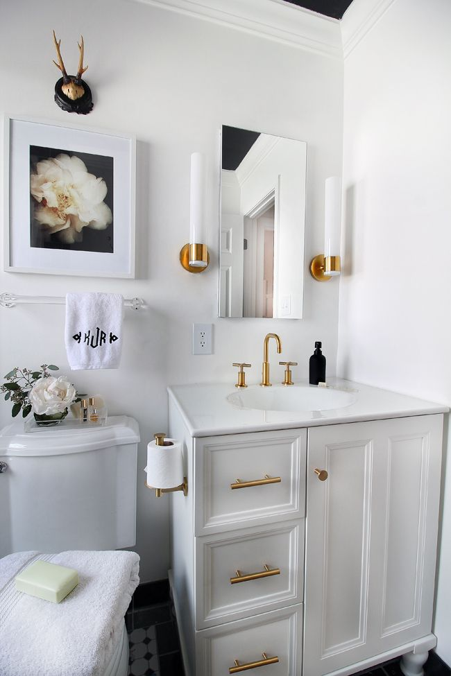 nice vanity and gold fixtures especially like how the toilet paper holder is vertical the hunted interior black white bathroom makeover - Bathroom Cabinet Ideas Design
