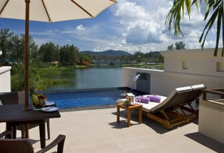 Atravelgo - Dusit Thani Laguna Phuket -  Part of a larger, integrated resort facility the Dusit Laguna Resort is situated in a lush, tropical garden location which is nestled along the Bang Tao Beach, and nearby to two inland lagoons. Additionally, the many recreational opportunities of the area, including golf, diving and swimming are in conjunction with the other hotels in the resort making it a full-service Phuket accommodation.    The Dusit Laguna Resort is located at 390 Srisoontorn…
