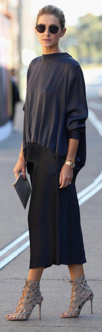 Black midi skirt, black sweatshirt, black clutch, grey sandals