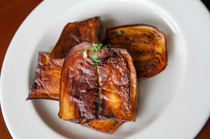 fried eggplant slices of eggplant fried and topped with a lemon garlic ...