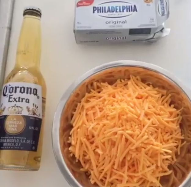 To make this queso, you need a bottle of beer, 1 cup (an 8-ounce package) cream cheese, and 1 cup of shredded cheddar cheese.
