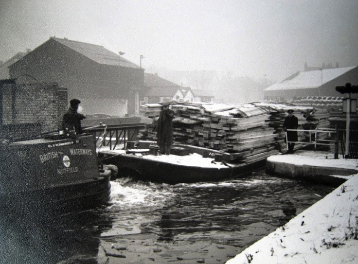 Scene at Brentford during the dreadful winter of 1962-63: the timber being worked was destined for James Davies (Timber) Merchants Ltd. at Hayes Bridge on the Paddington Arm.