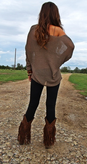Love the sweater and jean combo but I'd say more if a cowgirl boot instead of those boots.