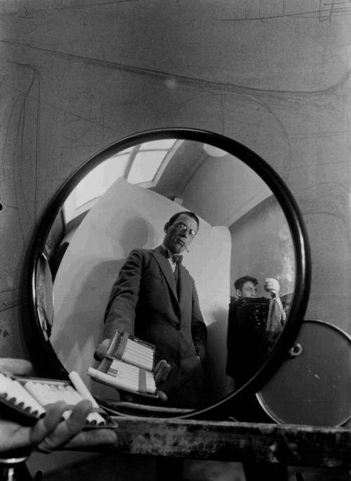 ca. 1928 Paul Schuitema,Self-Portrait in a mirror with Dick Elffers behind the camera