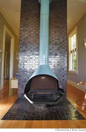 Modern rustic: Blue + brown living room with wood burning fireplace + Heath tile by xJavierx, via Flickr