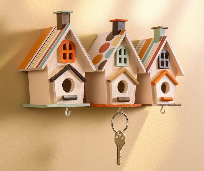 Turn wood birdhouses from the craft store into a cool key organizer that doubles as home decor!