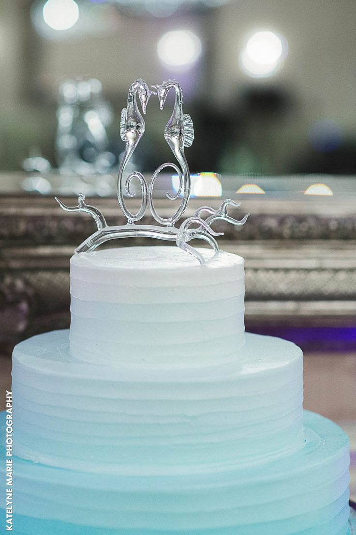 Stunning glass seahorse cake topper and calming ocean blue wedding cake