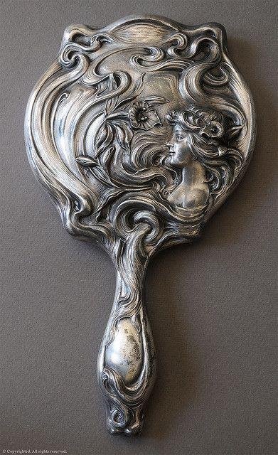 "Silver hand mirror by William B. Kerr circa 1901 ""American Beauty"" Series"