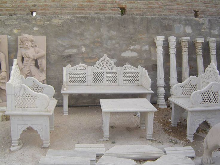 A complete sofa set of whtie marble three sofa and one center table make in indian white marble used hand made carved work.