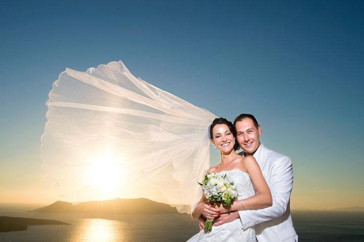 Sunset Santorini Stunning Bride Couple in love perfect moments Photoshooting wedding planners