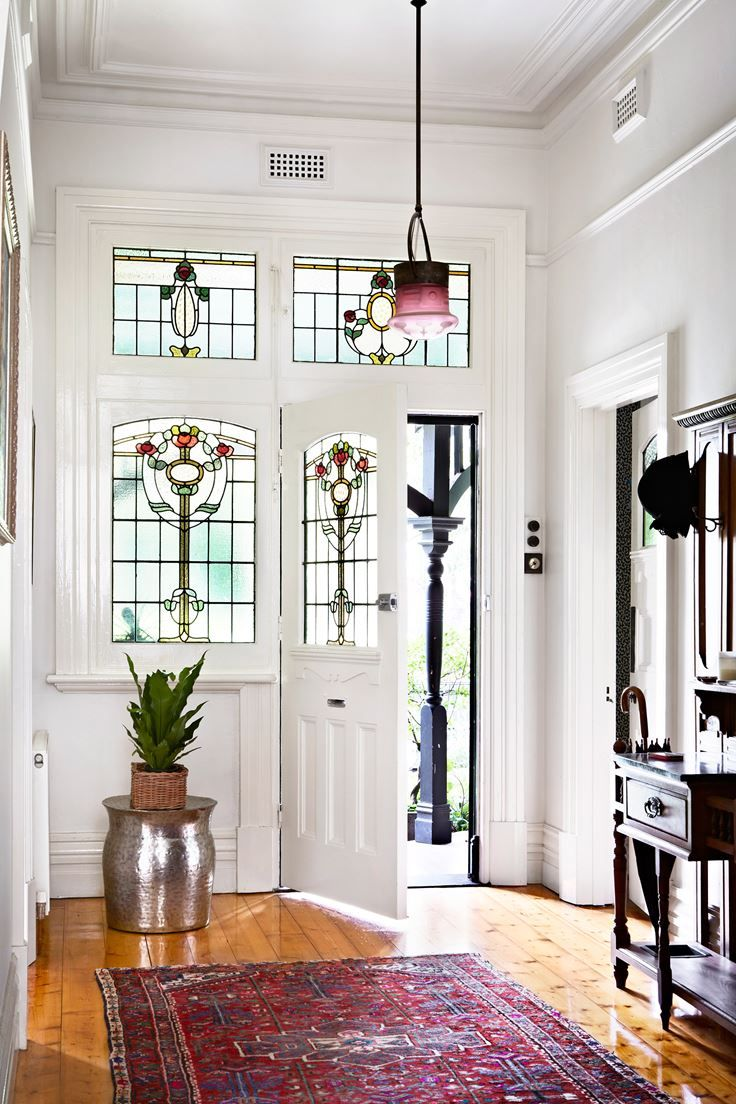 Stained-glass windows in the front hall are a welcome reminder of a bygone era.