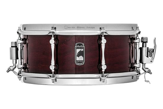 """Mapex Black Panther Blaster Snare Cherry Bomb  The use of cherry wood gives the thin 5.1mm shell of the Cherry Bomb extreme hardness, yielding an exceptionally bright yet dry tone that will help the drum cut live. The sharp 45 degree edge cut to the far outside of the shell increases sensitivity around the drumhead.     Size: 12"""" x 5""""      Material: 6ply Birch/Walnut Hybrid      Edge: Rounded 45° center-cut      Sound: Warm, Focused, & Sensitive"""