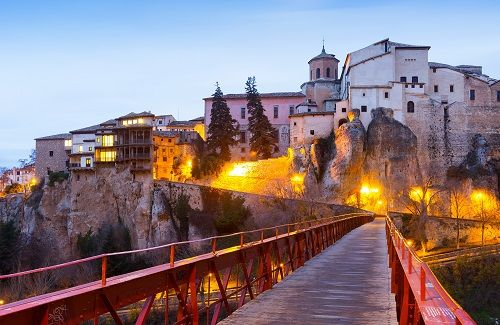 Best Places to Visit in Spain: The Hanging Houses of Cuenca. Cuenca is situated high atop a mountainside, with cliffs that overlook the Huecar River. The ancient buildings were meticulously constructed in harmony with the natural landscape, creating an architectural style that is both stunning and culturally unique.