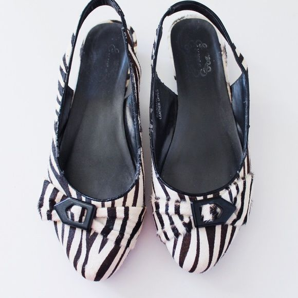 Zebra shoes Zebra shoes with a slight heel. Size 8.5. Only flaw is the cracking shown in the second photo. Bought at Nordstrom. Shoes Heels