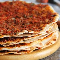 Traditional Turkish/Middle Eastern Lahmacun. A thin crust topped with a meat/vegetable mixture. Light and delicious! (+step by step photos)