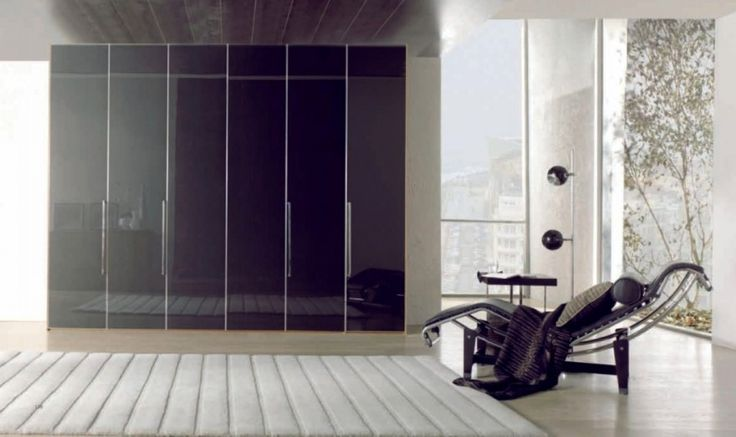 Stylish Wardrobe With Glossy Black Wardrobe Cabinet As Well As White Rugs Also Black Leather Chair With Curved Stainless Steel Frame Design Ideas: Beautify Your Room with Modern Minimalist Wardrobe Designs