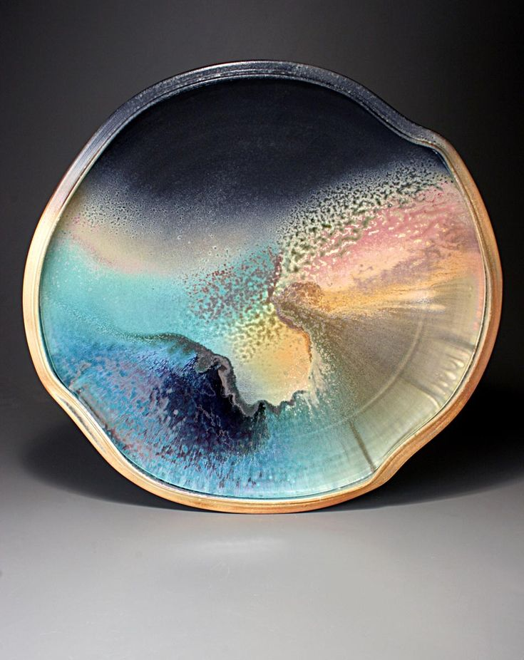 iridescent | mother-of-pearl | gleaming | shimmering | metallic rainbow | shine | anodized | holographic | oil slick | peacock | iridescence | Tom Coleman opalescent decorative bowl