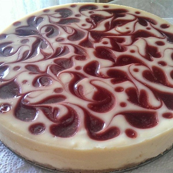 "White Chocolate Raspberry Cheesecake I ""Fabulous cheesecake. Not only does it taste awesome it is also beautiful in appearance - my guests thought it was from a bakery."""