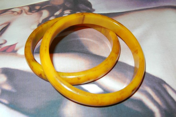 November sale many items reduced from 20 to 60% off Visit my Ruby Plaza Shop Link on home page Set of two beautiful Butterscotch Bakelite Bangle Bracelets from vintageshari on Ruby Lane