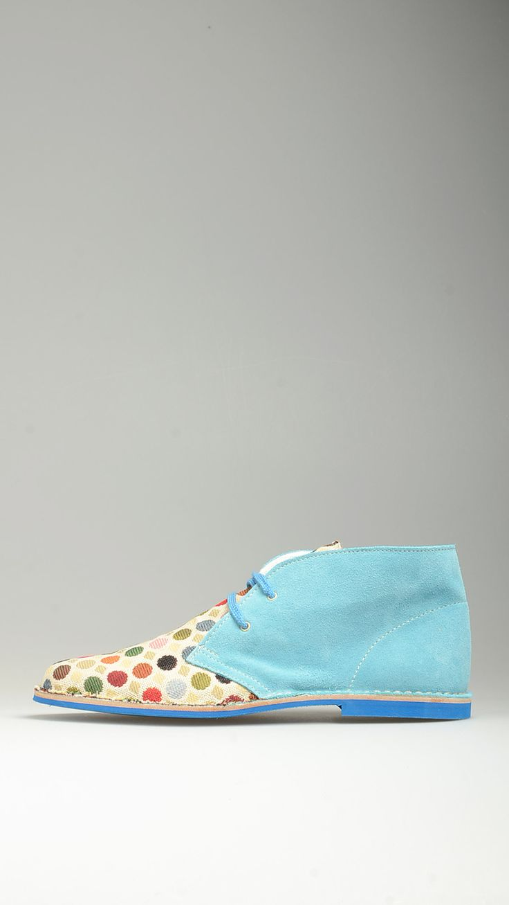Multicoloured polka-dot canvas uppers embellished azure suede lace-ups desert boots featuring blue contrast cotton laces, leather intersole, desert boots manufacturing process, antioxidant eyelets, raw edge stitching, lining, blue contrast rubber sole, 100% finest suede and canvas.