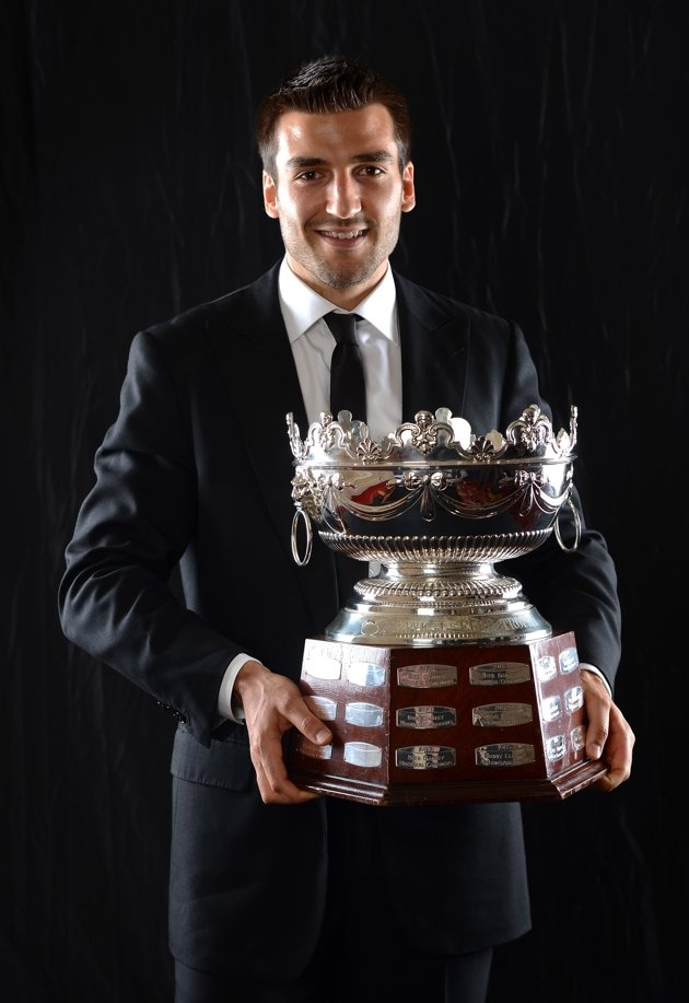 Cool trophy! Patrice Bergeron of the Boston Bruins poses after winning the Frank Selke Trophy during the 2012 NHL Awards