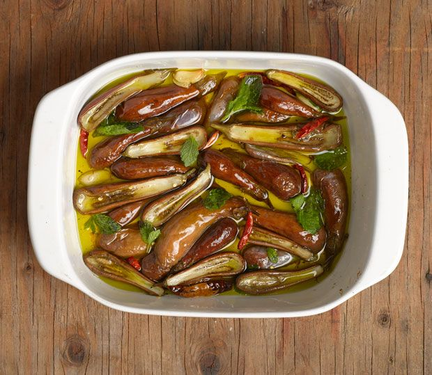 A recipe for preserving eggplants by roasting them slowly in olive oil and jarring them with basil or mint