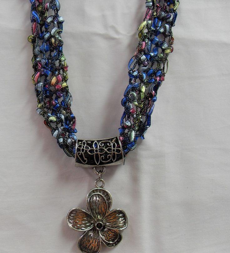 Pastel Rainbow - Ladder Trellis Ribbon Yarn - Hand Crocheted - Scarf - Cowl - Flower Pendant by ButterflyDreamsbyDeb on Etsy https://www.etsy.com/listing/448919762/pastel-rainbow-ladder-trellis-ribbon