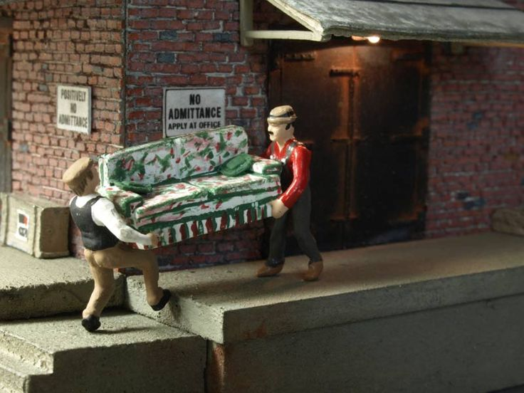 Miniatures. Chester Fields, and his struggling helper, Otto Mann, work as deliveryman for Vogue Furniture. Figures by Woodland Scenics Photo by Greg Shinnie