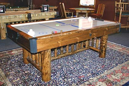 If you want your Air Hockey or Foosball tables to match your decor, Drawknife has the table for you.  Visit this site to check out their other gaming options for your rustic game room!
