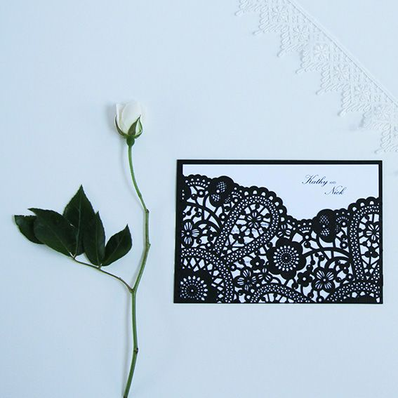 Floral Fantasy Black Invitations A beautifully cut floral invite gives a wonderfully whimsical feel to your invitations. The floral fantasy invitations are the perfect design for a classical wedding.