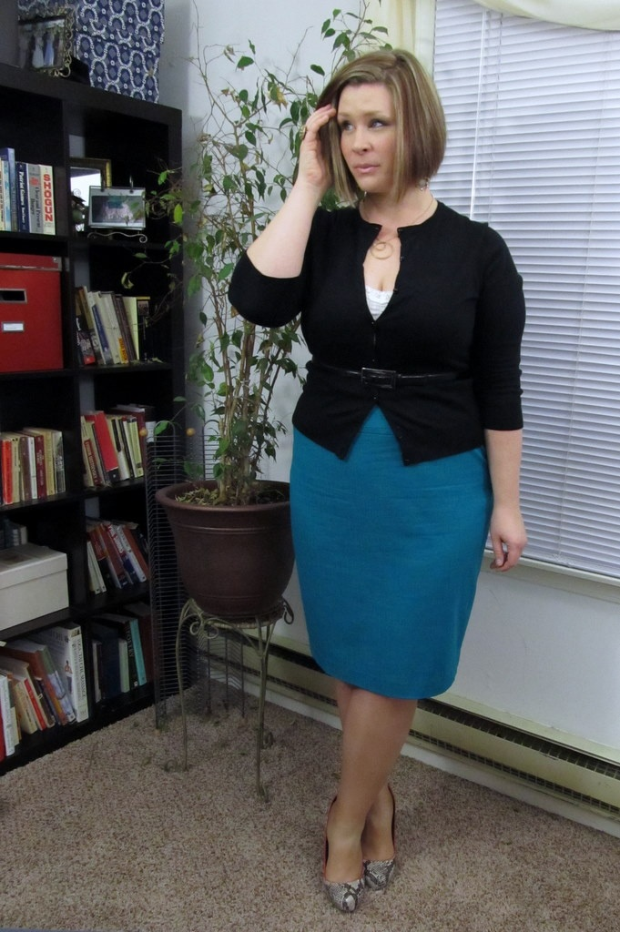 great pencil skirt & belted card combo--she looks a little worried though
