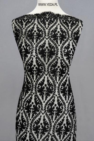 Koronka M461257 BLACK  Doskonała na suknie koktajlowe lub wieczorowe. Idealna dla druhen, świetnie prezentuje się na przyjęciach weselnych,studniówkach lub balach sylwestrowych.