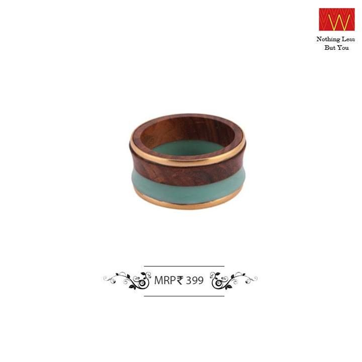 Team this wooden bangle with your favorite black dress! Buy it at the nearest #W store : http://shopforw.com/our-fashion-destinations.php