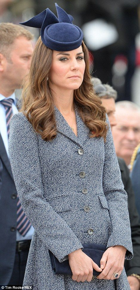 The Duchess wore navy ensemble with pillbox hat to the ceremony... http://dailym.ai/1f8izNs#i-aba80e88