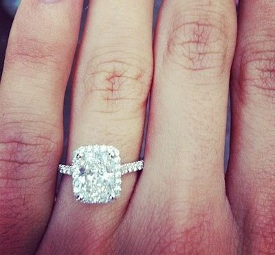 Gorgeous engagement ring. I like that it's more of a rectangle rather than perfectly square... A little different!