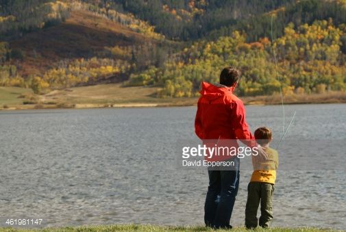 dad fishing in a lake   Father And Son Camping And Fishing At Lake Stock Photo   Getty Images