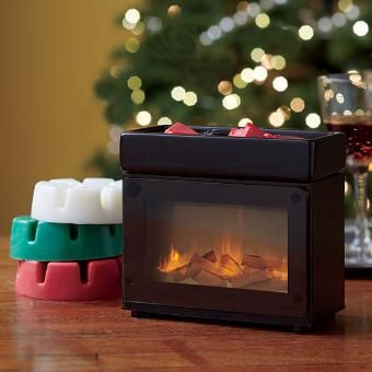our electric warmer mimics flickering flames as it releases the fragrance of scent plus melts sold separately
