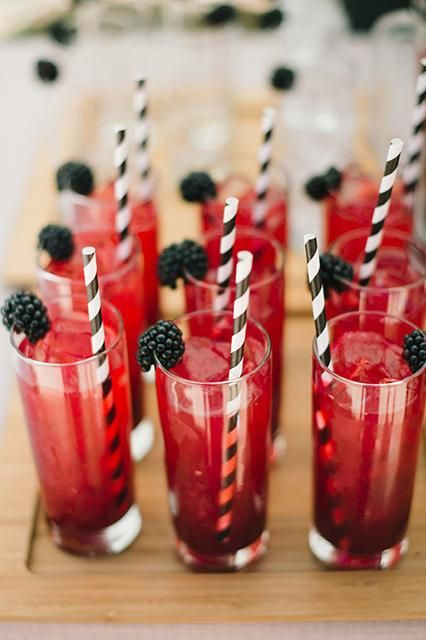 Berry lemonade with red and white striped straws