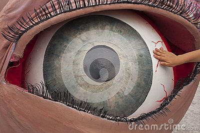 Giant Eye, Little Hand - Download From Over 23 Million High Quality Stock Photos, Images, Vectors. Sign up for FREE today. Image: 41104189