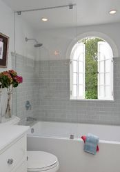 Shower over bath idea with glass divider
